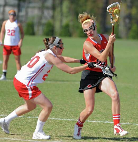 From left, Niskayuna's Ritchie Assini defends Guilderland's Shelby Iapoce during a lacrosse game on
