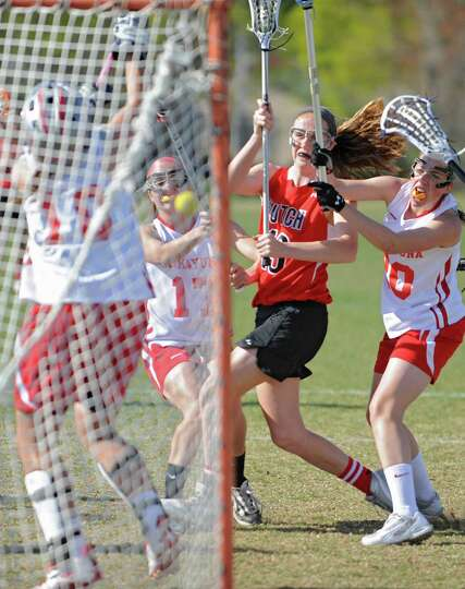Surrounded by Niskayuna players Guilderland's Kelly Camardo manages to score during a lacrosse game