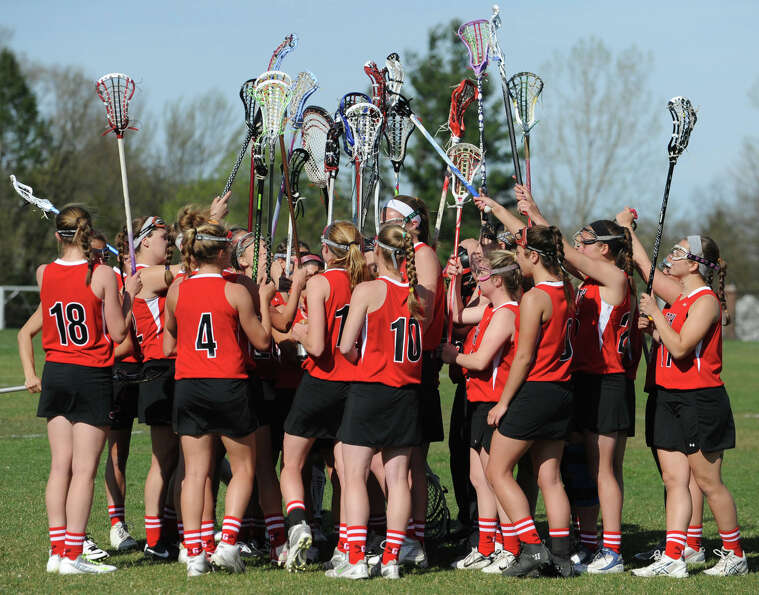 Guilderland wraps up a time out called by Niskayuna during a lacrosse game on April 17, 2012 in Nisk