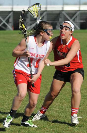 From left, Niskayuna's Cat Sexton is defended by Guilderland's Kara Carman during a lacrosse game on