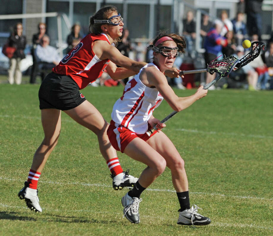 From left, Guilderland's Christine Bolognino uses a stick check to dislodge the ball from Niskayuna's Emily Ryan's stick during a lacrosse game on April 17, 2012 in Niskayuna, N.Y. (Lori Van Buren / Times Union) Photo: Lori Van Buren