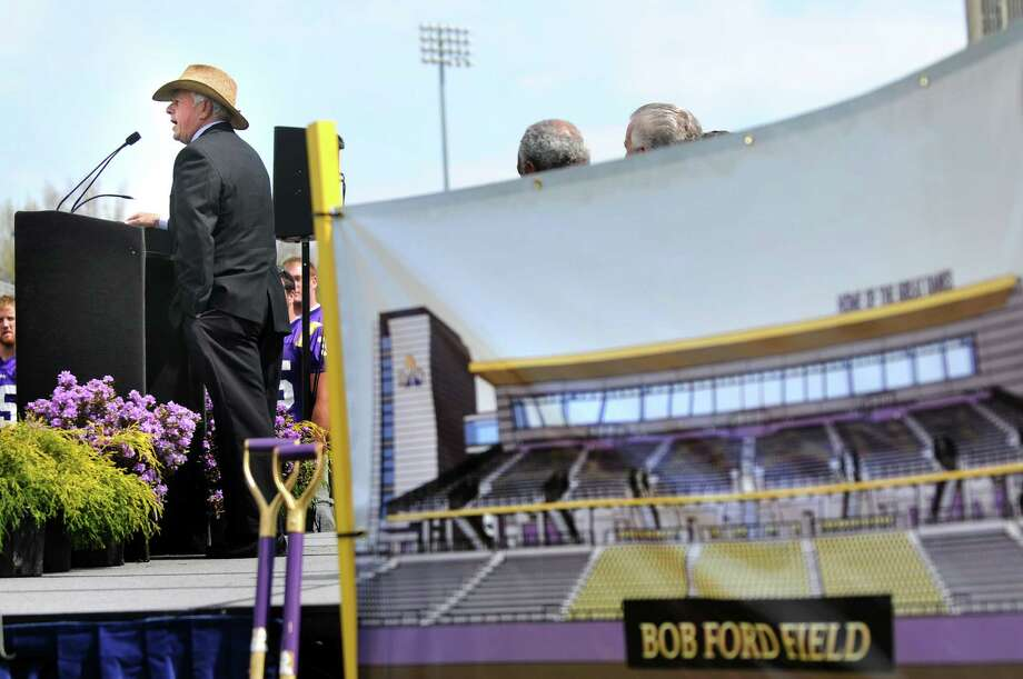 Football coach Bob Ford, left, speaks during the ceremonial groundbreaking of Ford Field, a multi-sports complex, on Tuesday, April 17, 2012, at the University at Albany in Albany, N.Y. (Cindy Schultz / Times Union) Photo: Cindy Schultz / 00017245A