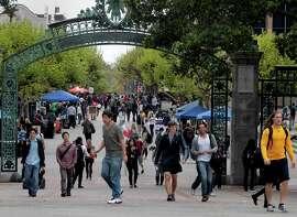 Students walk through Sather Gate at UC Berkeley.