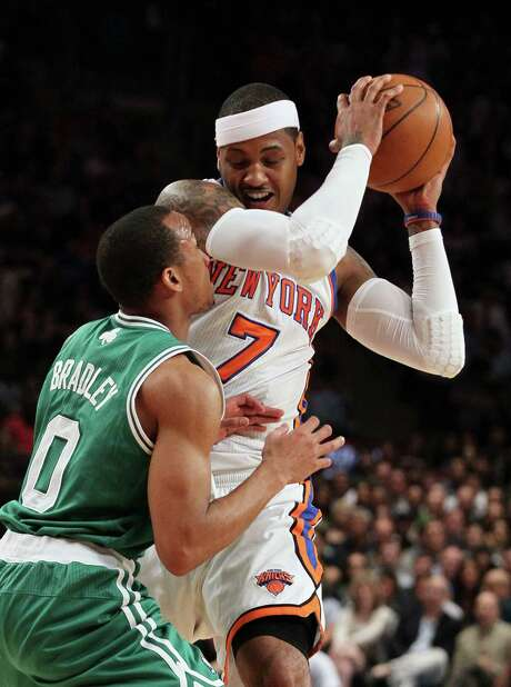 Carmelo Anthony abused Avery Bradley, left, and the Celtics for 35 points, 12 rebounds and 10 assists. Photo: Jim McIsaac / Newsday