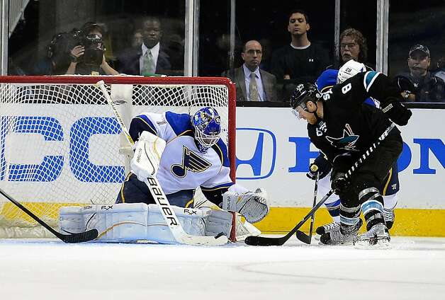 SAN JOSE, CA - APRIL 16:  Goaltender Brian Elliott #1 of the St Louis Blues blocks the backhand shot of Joe Pavelski #8 of the San Jose Sharks in the second period in Game Three of the Western Conference Quarterfinals during the 2012 NHL Stanley Cup Playoffs at HP Pavilion on April 16, 2012 in San Jose, California.  (Photo by Thearon W. Henderson/Getty Images) Photo: Thearon W. Henderson, Getty Images