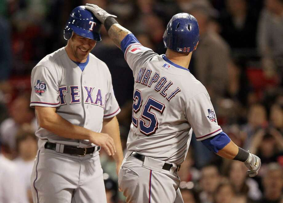 The Rangers enjoyed a laugher, thanks in part to two homers by Mike Napoli, right, including one in the ninth that scored David Murphy. Photo: Elsa / 2012 Getty Images