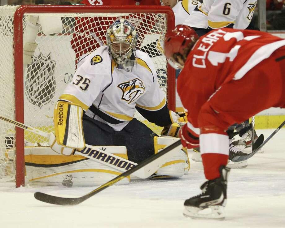 Predators goalie Pekka Rinne denies Danny Cleary from point-blank range. Photo: JULIAN H. GONZALEZ / Detroit Free Press
