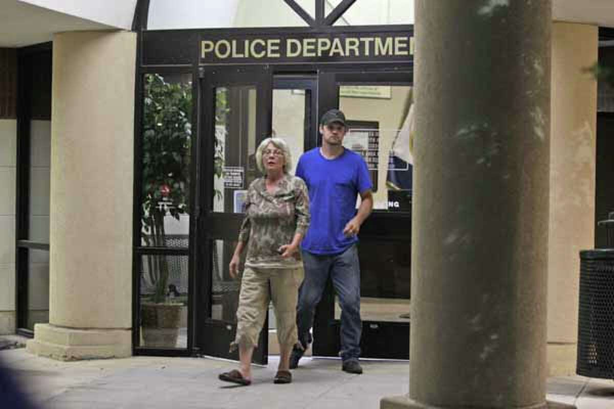 Linda Golden and son-in-law Keith Schuchardt leave the police station without the infant. (Melissa Phillip/Houston Chronicle)