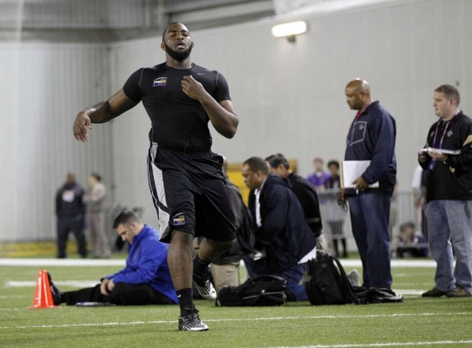 DT Michael Brockers, 6-5, 322, 5.34, LSU An awesome physical specimen with ideal size for an inside position. A third-year sophomore who didn't do well at the combine. Slower and weaker than scouts want but very athletic. Lots of potential. Will go in the first round. (Gerald Herbert / Associated Press)