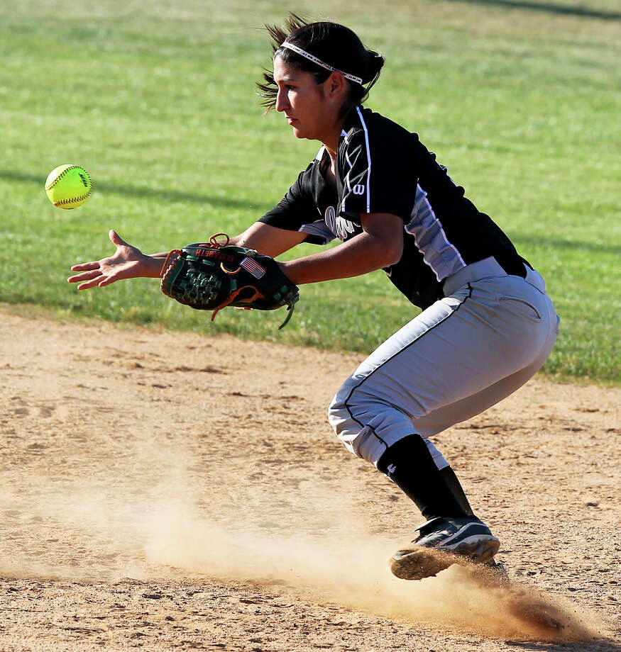 Clark shortstop Liz Rodriguez grabs the ball after knocking down a line drive as O'Connor beats Clark 1-0 at Northside Softball Field No. 1  on  April 17, 2012.  Tom Reel/ San Antonio EXpress-News Photo: TOM REEL, Express-News / San Antonio Express-News