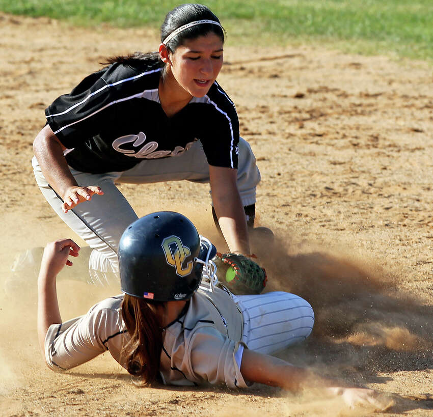 Clark shortstop Liz Rodriguez puts the tag out on Kendall Teague at second as O'Connor beats Clark 1-0 at Northside Softball Field No. 1 on April 17, 2012. Tom Reel/ San Antonio EXpress-News