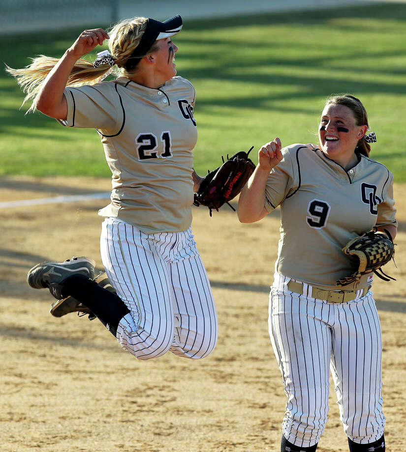 Kenedy Urbany jumps in celebration as teammate Maegan Taylor joins after O'Connor beats Clark 1-0 at Northside Softball Field No. 1  on  April 17, 2012.  Tom Reel/ San Antonio EXpress-News Photo: TOM REEL, Express-News / San Antonio Express-News