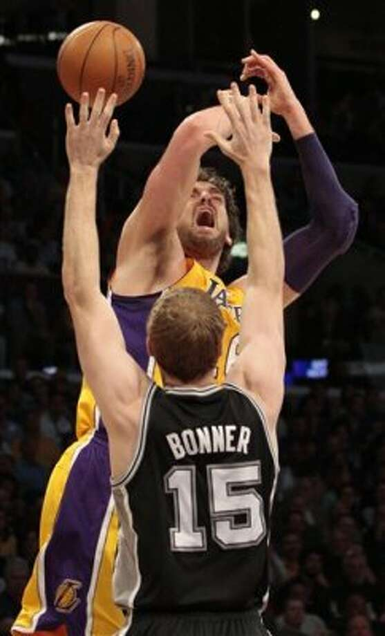 Los Angeles Lakers forward Pau Gasol of Spain goes for a shot as San Antonio Spurs forward Matt Bonner (15) defends during the first half of their NBA basketball game, Tuesday, April 17, 2012, in Los Angeles. (AP Photo/Jason Redmond) (AP)