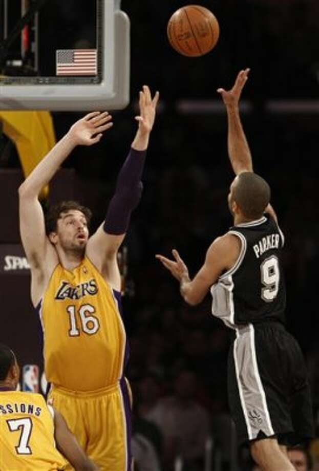 San Antonio Spurs guard Tony Parker (9), of France, shoots as Los Angeles Lakers' Pau Gasol (16) of Spain defends during the first half of their NBA basketball game, Tuesday, April 17, 2012, in Los Angeles. (AP Photo/Jason Redmond) (AP)