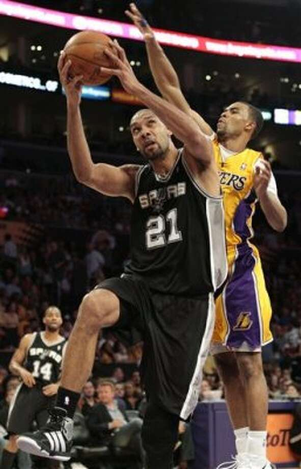 San Antonio Spurs forward Tim Duncan (21) goes for a layup as Los Angeles Lakers' Ramon Sessions defends during the second half of their NBA basketball game, Tuesday, April 17, 2012, in Los Angeles. The Spurs won 112-91. (AP Photo/Jason Redmond) (AP)