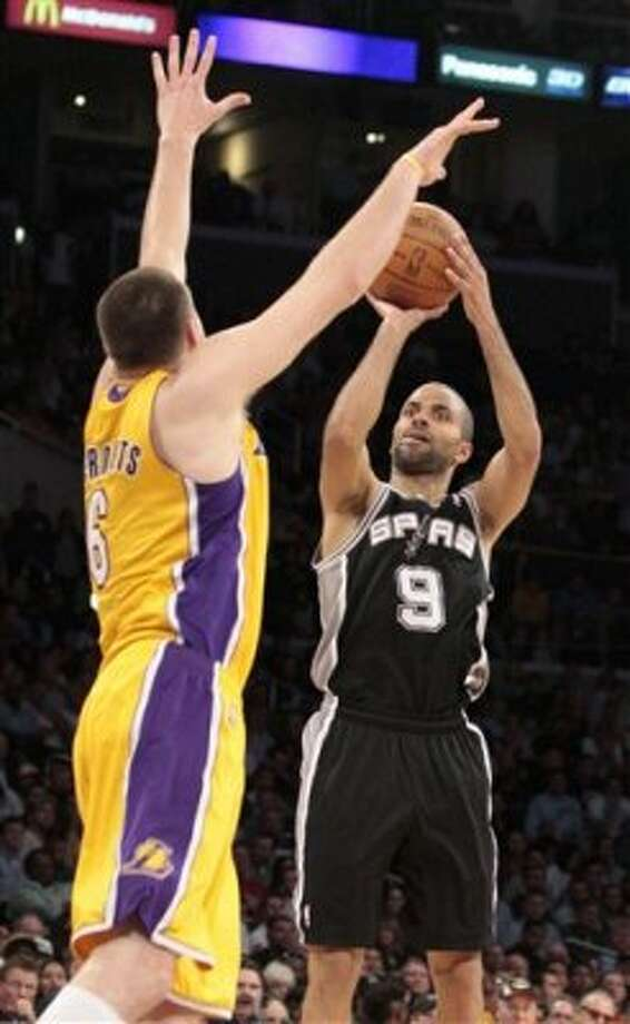 San Antonio Spurs guard Tony Parker (9), of France, shoots as Los Angeles Lakers' Josh McRoberts defends during the second half of their NBA basketball game, Tuesday, April 17, 2012, in Los Angeles. The Spurs won 112-91. (AP Photo/Jason Redmond) (AP)