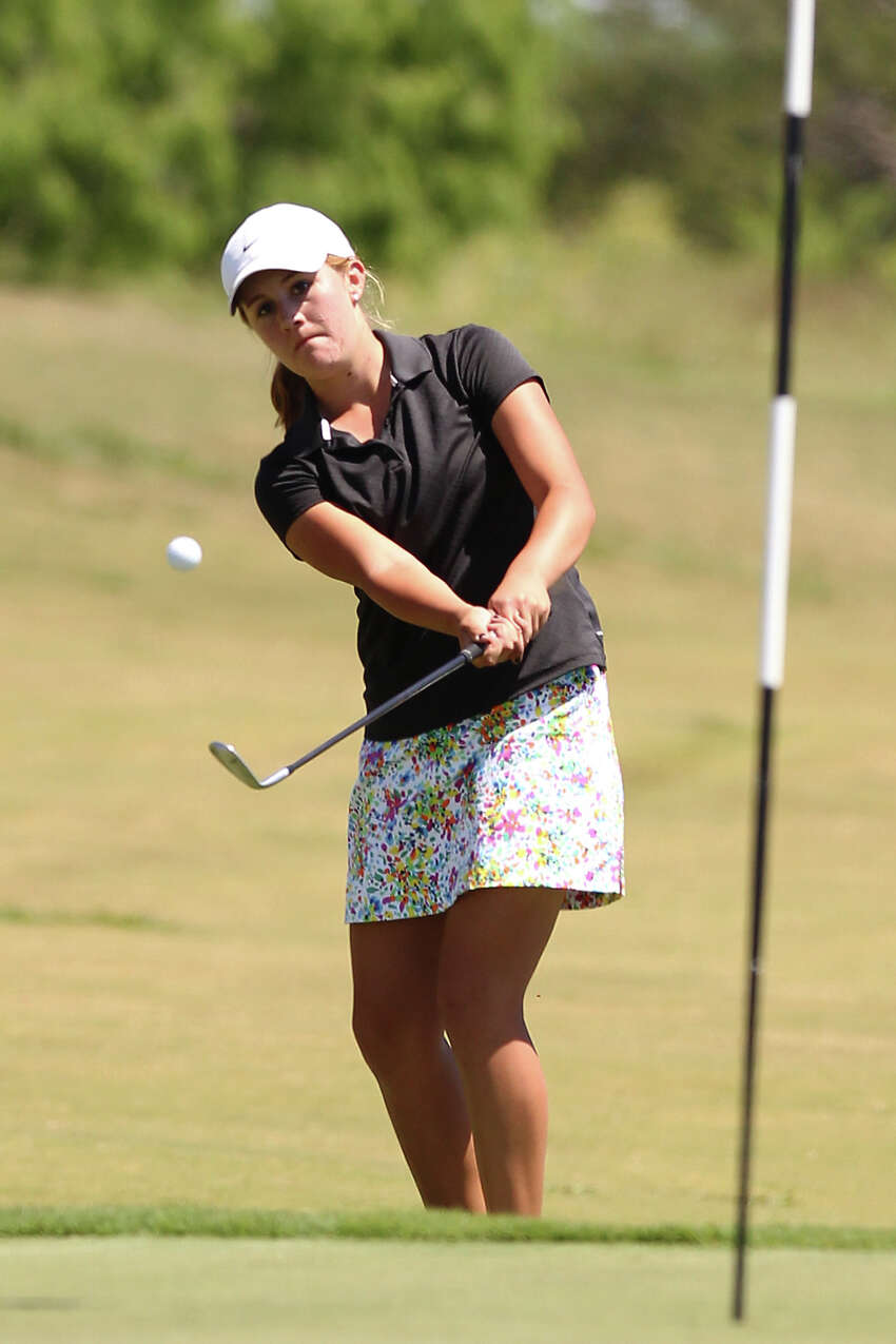 Buda Hays' Lindsey McCurdy pitches up to the No. 18 green at the Region IV-4A girls golf tournament at the Golf Club of Texas on Tuesday, Apr. 17, 2012. McCurdy won the tournament and will compete in the state tournament in the individual competition. Kin Man Hui/Express-News.