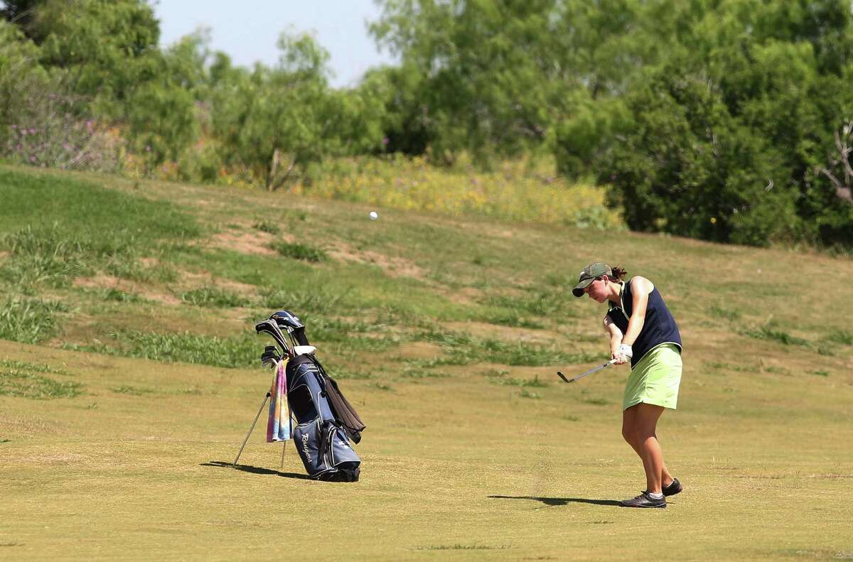Smithson Valley's Morgan Best hits her second shot at No. 18 at the Region IV-4A girls golf tournament at the Golf Club of Texas on Tuesday, Apr. 17, 2012. The Smithson Valley girls team took first place in the tournament over Austin Lake Travis by six strokes. Kin Man Hui/Express-News.