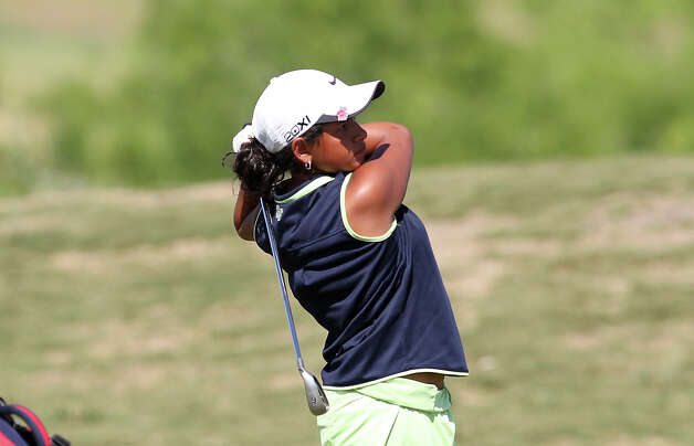 Smithson Valley's Johany Rivera watches her approach shot up to the No. 1 green during a playoff hole at the Region IV-4A girls golf tournament at the Golf Club of Texas on Tuesday, Apr. 17, 2012. Rivera won the playoff hole and took second place in the tournament. The Smithson Valley girls team took first place in the tournament beating out Austin Lake Travis by six strokes. Kin Man Hui/Express-News. Photo: Kin Man Hui, Express-News / ©2012 San Antonio Express-News