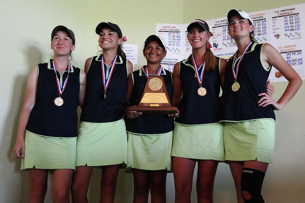 The Smithson Valley girls golf team of Morgan Best (from left), Megan Woods, Johany Rivera, Sydney Reed and Amanda Turney pose for photos after winning the Region IV-4A girls golf tournament at the Golf Club of Texas on Tuesday, Apr. 17, 2012. The team beat Austin Lake Travis by six strokes to take first place in the tournament. Rivera also earned second place in the individual competition in a playoff hole. Kin Man Hui/Express-News. Photo: Kin Man Hui, Express-News / ©2012 San Antonio Express-News