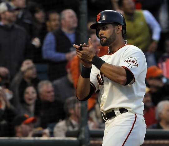 Angel Pagan celebrates after he scores in the first inning. The San Francisco Giants played the Philadelphia Phillies at AT&T Park in San Francisco, Calif., on Tuesday, April 17, 2012, and defeated the Phillies 4-2. Photo: Carlos Avila Gonzalez, The Chronicle