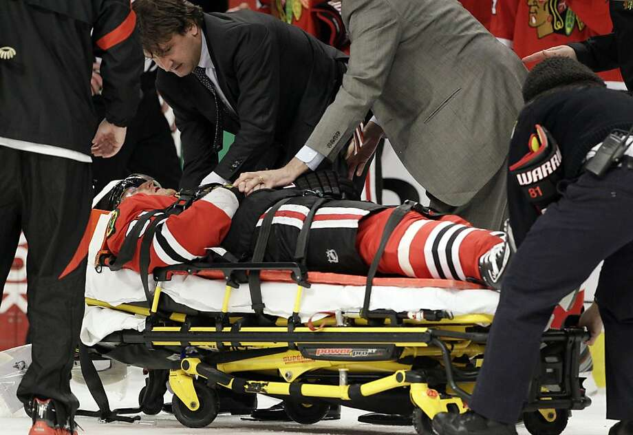 Chicago Blackhawks' Marian Hossa (81) of Russia, leaves the game after a hit from Phoenix Coyotes' Raffi Torres (37) during the first period of Game 3 of an NHL hockey Stanley Cup first-round playoff series in Chicago, Tuesday, April 17, 2012. (AP Photo/Nam Y. Huh) Photo: Nam Y. Huh, Associated Press