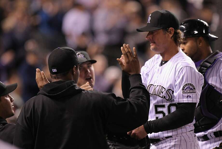 DENVER, CO - APRIL 17:  Starting pitcher Jamie Moyer #50 of the Colorado Rockies returns to the dugout as he exits the game after the seventh inning against the San Diego Padres at Coors Field on April 17, 2012 in Denver, Colorado. Moyer became the oldest pitcher in the major leagues to earn a win as the Rockies defeated the Padres 5-3.  (Photo by Doug Pensinger/Getty Images) Photo: Doug Pensinger, Getty Images