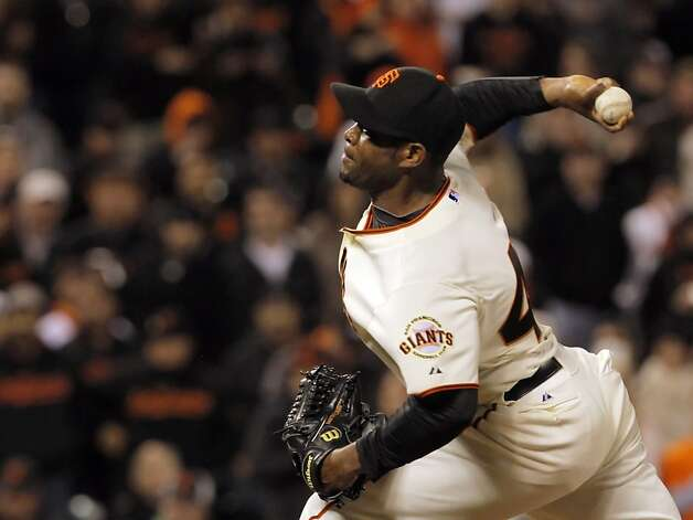 Santiago Casilla pitches in the ninth inning and saved the game for the Giants. The San Francisco Giants played the Philadelphia Phillies at AT&T Park in San Francisco, Calif., on Tuesday, April 17, 2012, and defeated the Phillies 4-2. Photo: Carlos Avila Gonzalez, The Chronicle