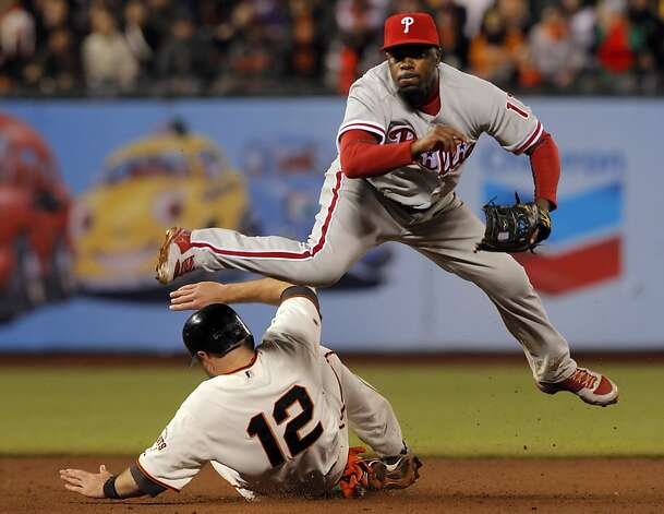 Jimmy Rollins tries to complete the double play on a hit by Brandon Crawford, but Nate Schierholtz is able to break it up allowing Buster Posey to score from third in the fifth inning. The San Francisco Giants played the Philadelphia Phillies at AT&T Park in San Francisco, Calif., on Tuesday, April 17, 2012, and defeated the Phillies 4-2. Photo: Carlos Avila Gonzalez, The Chronicle