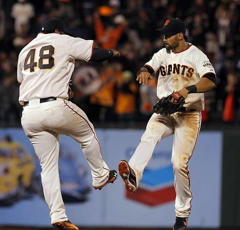 Pablo Sandoval and Angel Pagan celebrate the Giants victory at the end of the game. The San Francisco Giants played the Philadelphia Phillies at AT&T Park in San Francisco, Calif., on Tuesday, April 17, 2012, and defeated the Phillies 4-2. Photo: Carlos Avila Gonzalez, The Chronicle