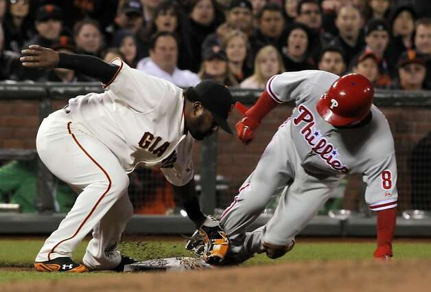 Shane Victorino steals third ahead of the tag by Pablo Sandoval in the third inning. The San Francisco Giants played the Philadelphia Phillies at AT&T Park in San Francisco, Calif., on Tuesday, April 17, 2012, and defeated the Phillies 4-2. Photo: Carlos Avila Gonzalez, The Chronicle