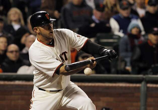 Madison Bumgarner bunts in fourth inning against the Phillies. The San Francisco Giants played the Philadelphia Phillies at AT&T Park in San Francisco, Calif., on Tuesday, April 17, 2012, and defeated the Phillies 4-2. Photo: Carlos Avila Gonzalez, The Chronicle