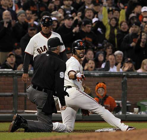 Angel Pagan calls for time after sliding in safe to third on his triple in the second inning. The San Francisco Giants played the Philadelphia Phillies at AT&T Park in San Francisco, Calif., on Tuesday, April 17, 2012, and defeated the Phillies 4-2. Photo: Carlos Avila Gonzalez, The Chronicle