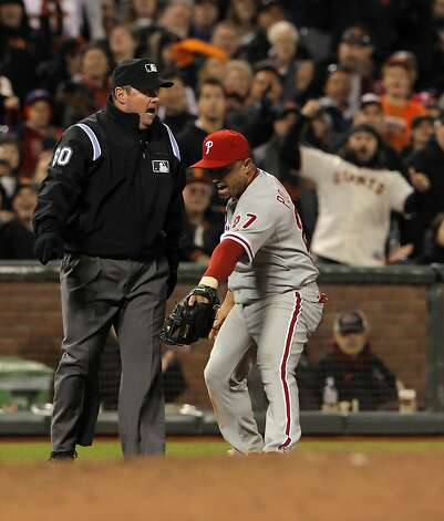Placido Polanco argues a safe call by third base umpire Marty Foster on a stolen base by Buster Posey in the fifth inning. The San Francisco Giants played the Philadelphia Phillies at AT&T Park in San Francisco, Calif., on Tuesday, April 17, 2012, and defeated the Phillies 4-2. Photo: Carlos Avila Gonzalez, The Chronicle
