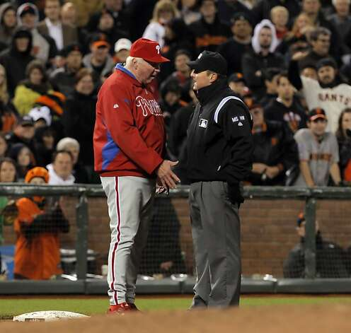 Phillies manager Charlie Manuel argues a safe call by third base umpire after Buster Posey stole third in the fifth inning. The San Francisco Giants played the Philadelphia Phillies at AT&T Park in San Francisco, Calif., on Tuesday, April 17, 2012, and defeated the Phillies 4-2. Photo: Carlos Avila Gonzalez, The Chronicle