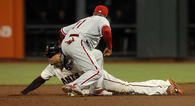 Emmanuel Burriss steals second ahead of the tag by Jimmy Rollins in the eighth inning. The San Francisco Giants played the Philadelphia Phillies at AT&T Park in San Francisco, Calif., on Tuesday, April 17, 2012, and defeated the Phillies 4-2. Photo: Carlos Avila Gonzalez, The Chronicle