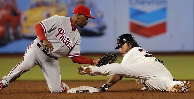 Brandon Crawford caught stealing by Jimmy Rollins in the fifth inning. The San Francisco Giants played the Philadelphia Phillies at AT&T Park in San Francisco, Calif., on Tuesday, April 17, 2012, and defeated the Phillies 4-2. Photo: Carlos Avila Gonzalez, The Chronicle