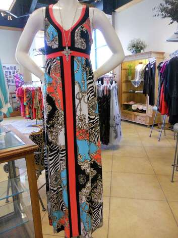 Grove Hill Ltd. carries this Frank Lyman Designs dress, $262, and Virgins, Saints and Angels necklace, $214. Photo: Jennifer Rodriguez, For The Express-News