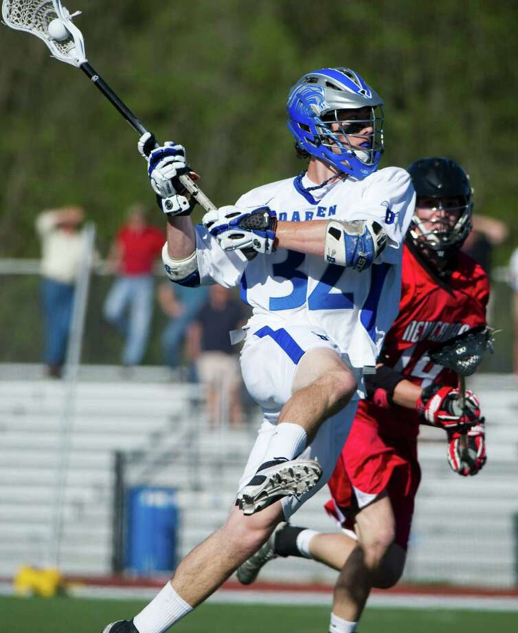 Darien's Henry West fires as Darien High School hosts New Canaan in a boys lacrosse game in Darien, Conn., April 17, 2012.  West had a hat trick in the first half of the game. Photo: Keelin Daly / Stamford Advocate