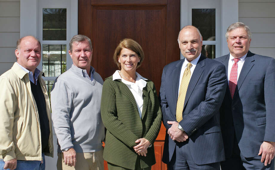Pictured are Paul Hertz and John Hertz, co-owners of Hertz Construction; Jayme Stevenson, Darien First Selectman; Rick Zaremski, First County Bank senior vice president and director of commercial lending; and Jim Darling, First County Bank vice president of business banking. Photo: Contributed Photo