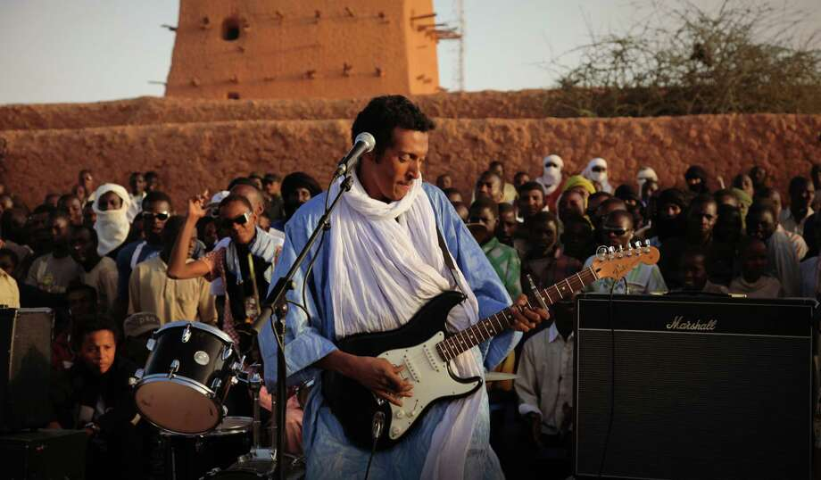 Bombino, born Omara Moctar, fuses the traditional music of his Tuareg people with contemporary sounds, including the electric guitar. Photo: Ron Wyman