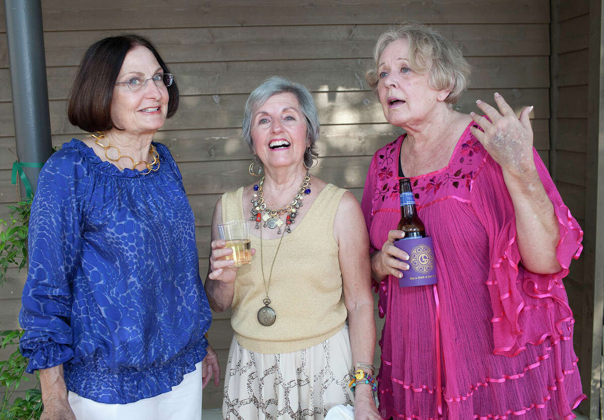 Committee member Kathleen Garrison (from left), event chairwoman Marie Ann Smith and committee member Virginia Allison get together during the Opera Guild of San Antonio's Vino Fiesta fundraiser at Casa Navarro.
