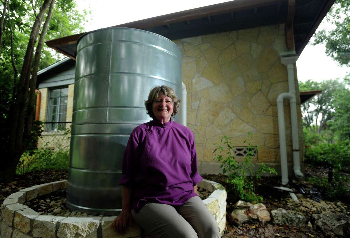 Ellen Clegg has a 500-gallon rainwater harvesting system which she uses for landscaping and gardening at her home in Terrell Hills. April 13, 2012.