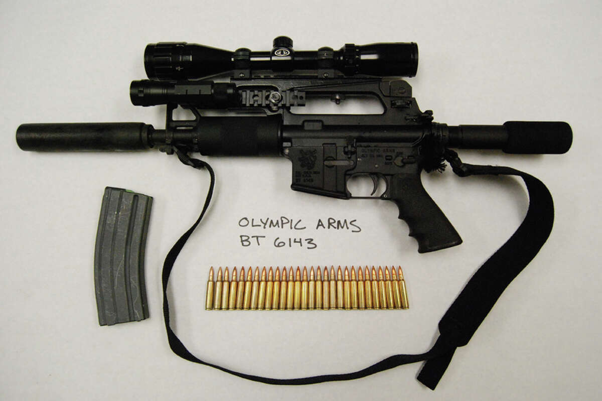 An AR-15-style rifle with silencer attached bought during a recent undercover sting operation targeting gun traffickers.