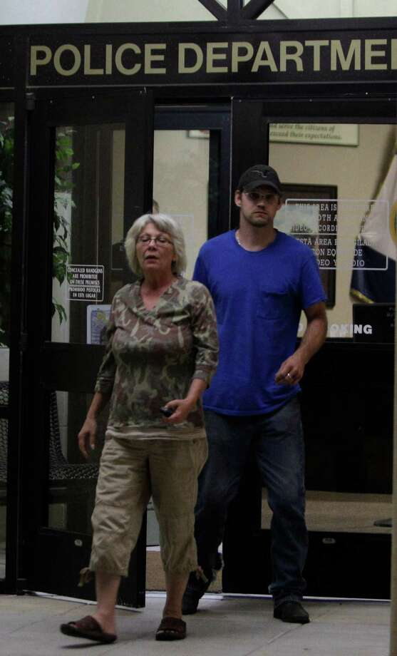 Linda Golden and her son-in-law, Keith Schuchardt, leave from the Conroe Police Dept. early Wednesday, April 18, 2012.  Keith's 3-day-old newborn son, Keegan Schuchardt,  was abducted from his wife, Kala GoldenSchuchardt, in parking lot of a medical clinic on Tuesday.  She was shot by the abductor and later died at the hospital. The family went to the police dept. in hopes of picking up Keegan, but were told they would have to wait for background checks before the baby could be released. Photo: Melissa Phillip, Houston Chronicle / © 2012 Houston Chronicle
