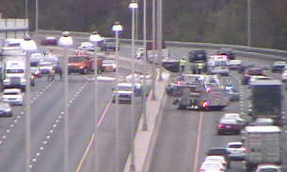 A tractor-trailer truck and several cars collided about 2:45 p.m. Wednesday on Interstate 95, near southbound Exit 24, in Fairfield. Debris from the truck flew into northbound travel lanes, tying up traffic in that direction. Photo: DOT Traffic Camera / Fairfield Citizen contributed