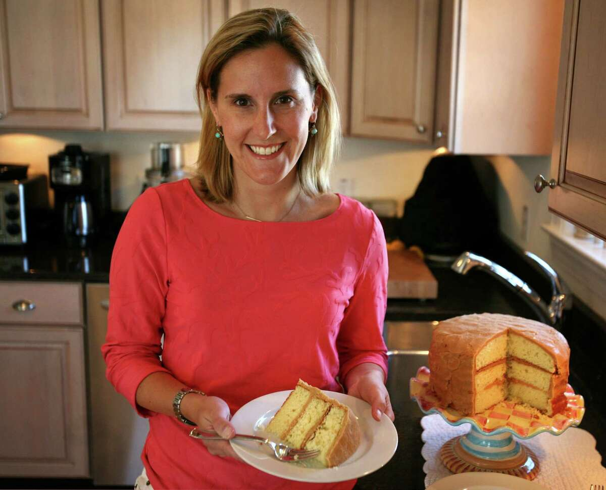 Cookbook author Kelsey Banfield with a piece of her Caramel Layer Cake in her kitchen in Fairfield on Tuesday, March 27, 2012.