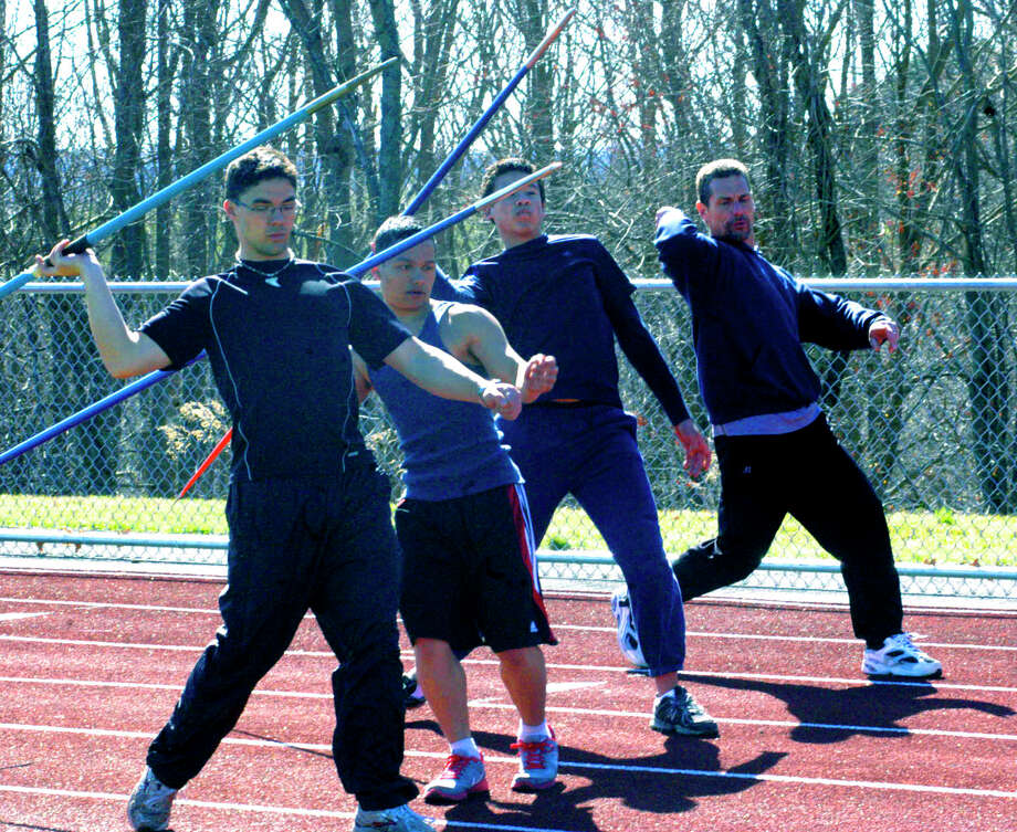 SPECTRUM/Coach Tom Scarola works with Spartan javelin hopefuls, from left to right, Matt Stager, Vinny Collins and David Geyer, for Shepaug Valley High School boys' track. April 2012 Photo: Norm Cummings