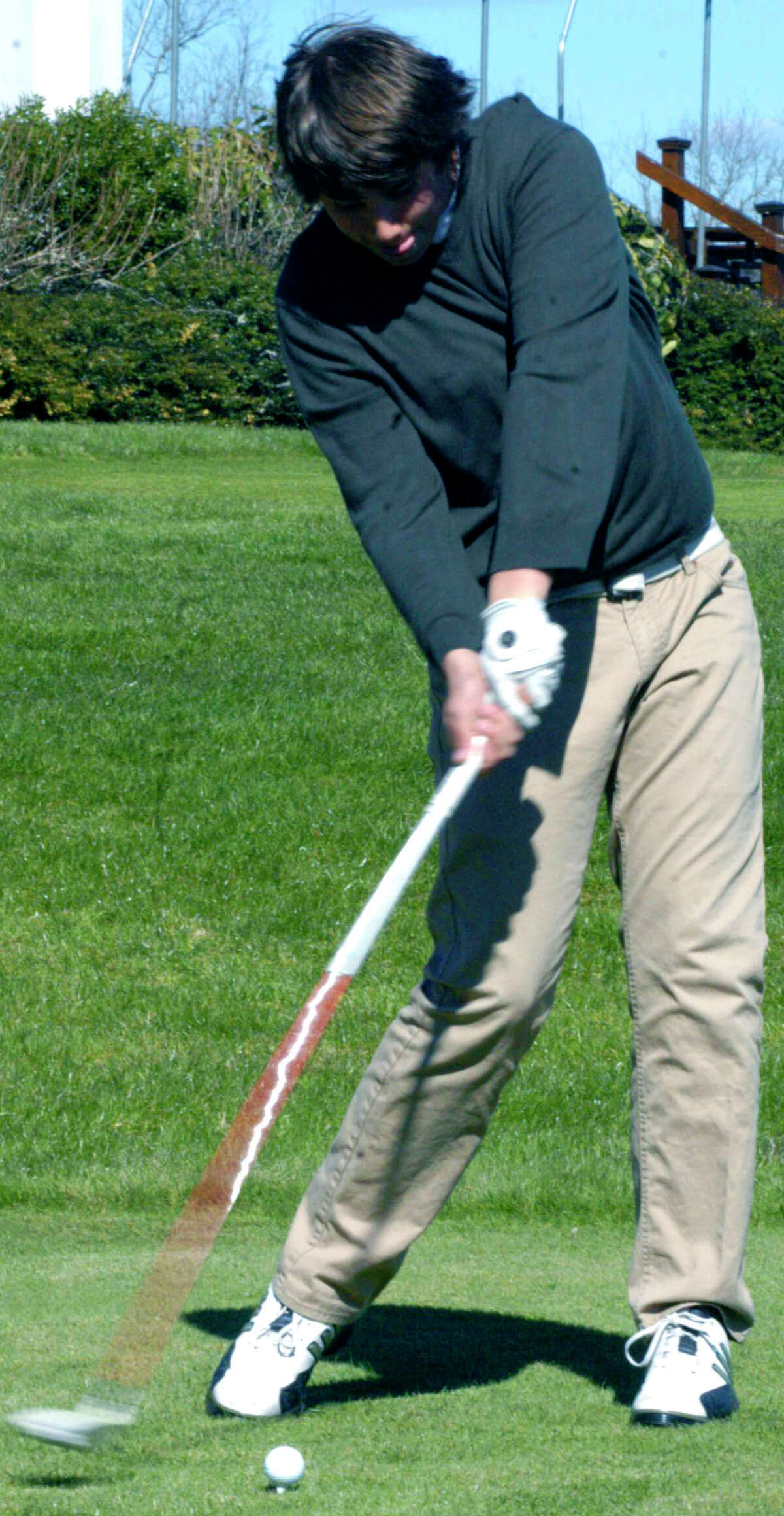 SPECTRUM/Robert McCarthy of the Spartans demonstrates impressive torque as he practices for the Shepaug Valley High School golf season. April 2012