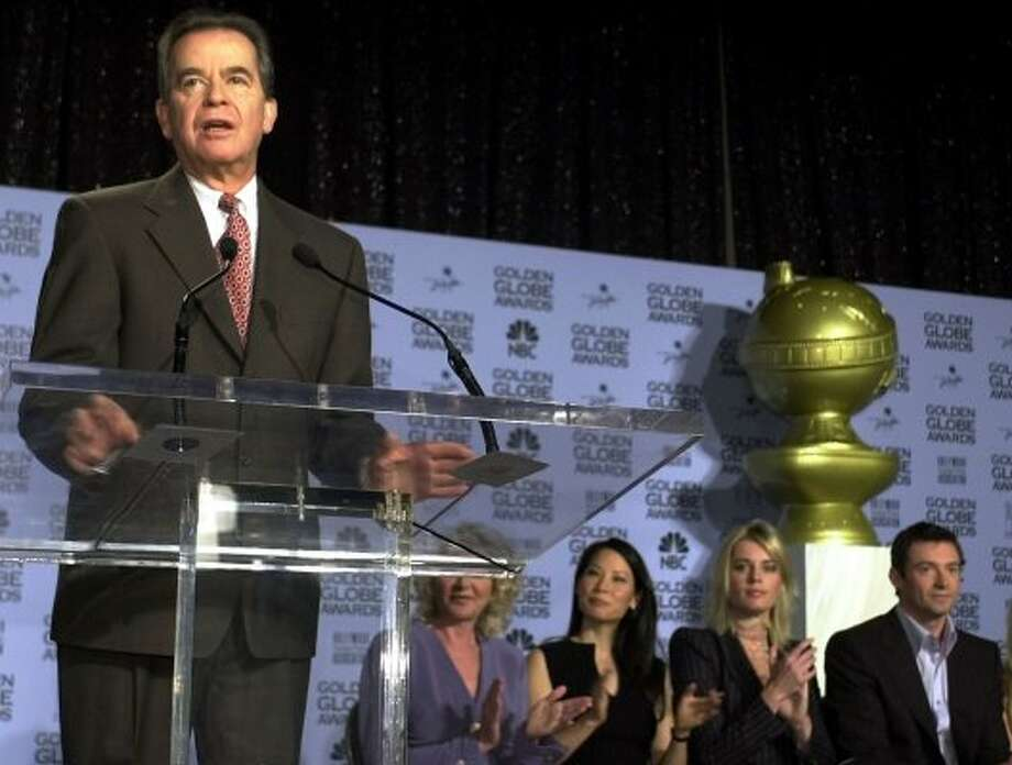 Producer Dick Clark, left, introduces the nominations for the 2002 Golden Globe Awards Thursday, Dec. 20, 2001 in Beverly Hills, Calif. Hollywood Foreign Press Association President Dagmar Dunlevy,  second from left, actors Lucy Liu, Rebecca Romijn-Stamos, and Hugh Jackman participated in the televised event. (AP Photo/Kim D. Johnson) (KIM D. JOHNSON / AP)
